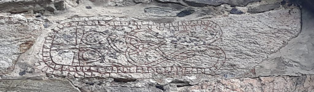 rune stone in church gable